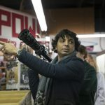 """Writer-director M. Night Shyamalan on the set of """"Glass,"""" the third part of his trilogy that began with 2000's """"Unbreakable"""" and continued with 2016's """"Split."""""""